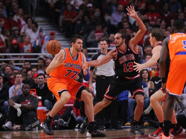 Oct 31, 2013; Chicago, IL, USA; New York Knicks power forward Andrea Bargnani (77) and Chicago Bulls center Joakim Noah (13) fight for the ball during the second half at the United Center. Chicago won 82-81. Mandatory Credit: Dennis Wierzbicki-USA TODAY Sports