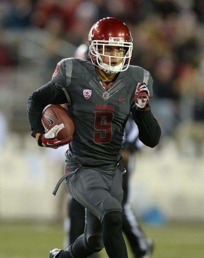 Oct 31, 2013; Pullman, WA, USA; Washington State Cougars receiver Gabe Marks (9) scores on a 34-yard touchdown reception in the second quarter against the Arizona State Sun Devils at Martin Stadium. Mandatory Credit: Kirby Lee-USA TODAY Sports