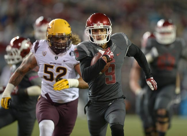 Oct 31, 2013; Pullman, WA, USA; Washington State Cougars receiver Gabe Marks (9) is pursued by Arizona State Sun Devils linebacker Carl Bradford (52) on a 34-yard touchdown reception in the second quarter at Martin Stadium. Mandatory Credit: Kirby Lee-USA TODAY Sports