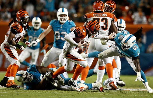 Oct 31, 2013; Miami Gardens, FL, USA;  Cincinnati Bengals quarterback Andy Dalton (14) is sacked by Miami Dolphins defensive tackle Paul Soliai (96) and middle linebacker Dannell Ellerbe (59) in the second half at Sun Life Stadium.  Miami won 22-20. Mandatory Credit: Robert Mayer-USA TODAY Sports