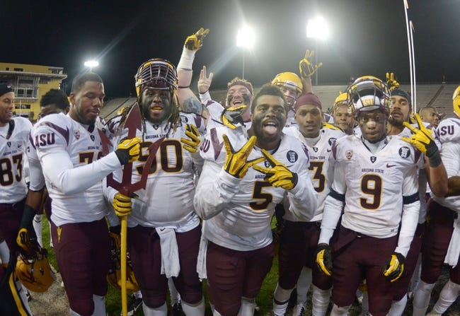 Oct 31, 2013; Pullman, WA, USA; Arizona State Sun Devils players Will Sutton (90), and Chris Young (5) and Robert Nelson (9) celebrate at the end of the game against the Washington State Cougars at Martin Stadium. Arizona State defeated Washington State 55-21. Mandatory Credit: Kirby Lee-USA TODAY Sports