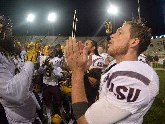 Oct 31, 2013; Pullman, WA, USA; Arizona State Sun Devils quarterback Taylor Kelly (10) celebrates at the end of the game against the Washington State Cougars at Martin Stadium. Arizona State defeated Washington State 55-21. Mandatory Credit: Kirby Lee-USA TODAY Sports