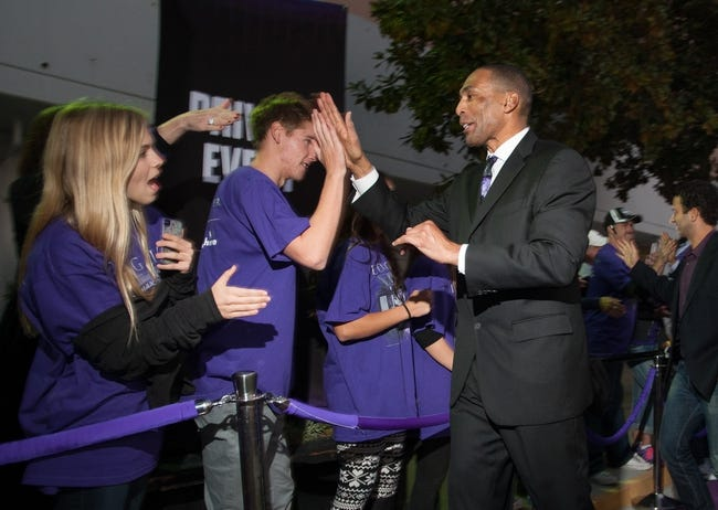 Oct 30, 2013; Sacramento, CA, USA; San Francisco 49ers former player Roger Craig high fives fans upon entering the Sleep Train Arena for the game between the Sacramento Kings and Denver Nuggets. Mandatory Credit: Ed Szczepanski-USA TODAY Sports