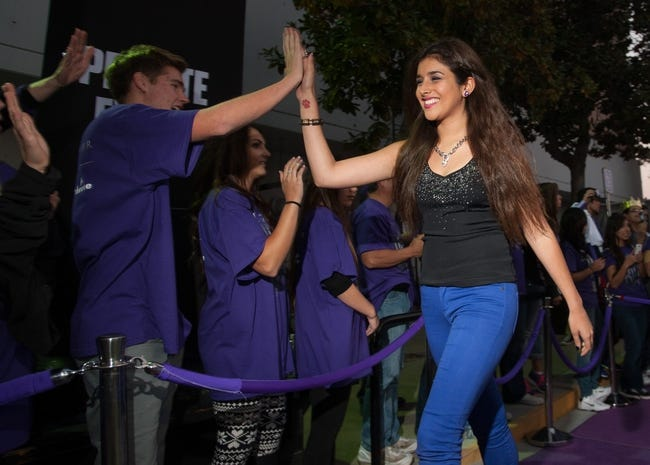 Oct 30, 2013; Sacramento, CA, USA; Anjali Ranadive, daughter of Sacramento Kings owner Vivek Ranadive (not pictured), high fives fans upon entering the Sleep Train Arena before the game between the Sacramento Kings and Denver Nuggets. Mandatory Credit: Ed Szczepanski-USA TODAY Sports