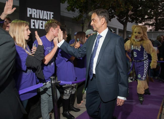 Oct 30, 2013; Sacramento, CA, USA; Sacramento Kings owner Vivek Ranadive high fives fans upon entering the Sleep Train Arena before the game between the Sacramento Kings and Denver Nuggets. Mandatory Credit: Ed Szczepanski-USA TODAY Sports