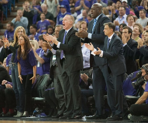 Oct 30, 2013; Sacramento, CA, USA; Sacramento Kings advisor Chris Mullin (left) and owner Shaquille O'Neal (middle) and owner Vivek Ranadive (right) celebrate after the Kings scored on the Denver Nuggets during the fourth quarter at Sleep Train Arena. Mandatory Credit: Ed Szczepanski-USA TODAY Sports