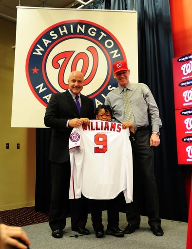 Nov 1, 2013; Washington, DC, USA; Washington Nationals general manager Mike Rizzo (left) holds up a jersey with manager Matt Williams (right) during the press conference at Nationals Park. Mandatory Credit: Evan Habeeb-USA TODAY Sports