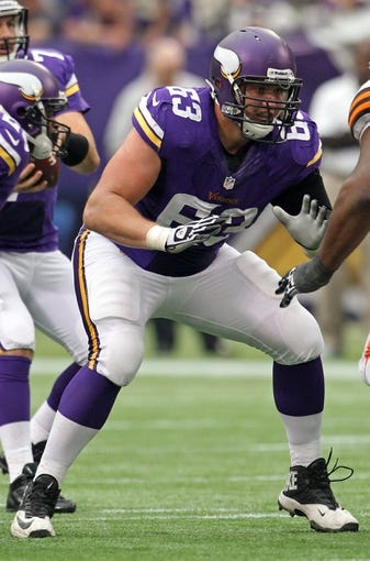 Sep 22, 2013; Minneapolis, MN, USA; Minnesota Vikings offensive lineman Brandon Fusco (63) against the Cleveland Browns at Mall of America Field at H.H.H. Metrodome. The Browns defeated the Vikings 31-27. Mandatory Credit: Brace Hemmelgarn-USA TODAY Sports