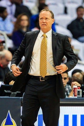 Nov 1, 2013; Atlanta, GA, USA; Atlanta Hawks head coach Mike Budenholzer reacts to a play in the first quarter against the Toronto Raptors at Philips Arena. Mandatory Credit: Daniel Shirey-USA TODAY Sports