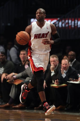 Nov 1, 2013; Brooklyn, NY, USA; Miami Heat shooting guard Dwyane Wade (3) controls the ball against the Brooklyn Nets during the first quarter of a game at Barclays Center. Mandatory Credit: Brad Penner-USA TODAY Sports