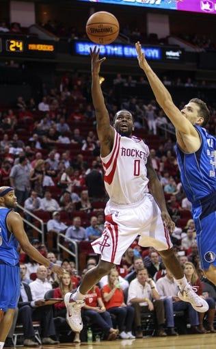Nov 1, 2013; Houston, TX, USA; Houston Rockets point guard Aaron Brooks (0) scores a basket during the second quarter against the Dallas Mavericks at Toyota Center. Mandatory Credit: Troy Taormina-USA TODAY Sports