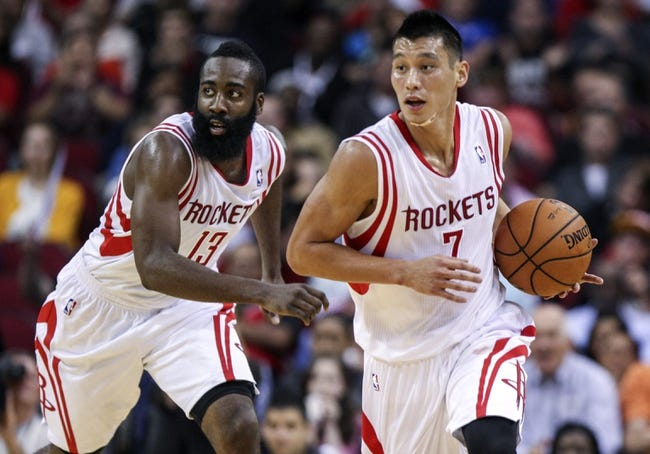 Nov 1, 2013; Houston, TX, USA; Houston Rockets point guard Jeremy Lin (7) and shooting guard James Harden (13) run up the court after Lin makes a steal during the second quarter against the Dallas Mavericks at Toyota Center. Mandatory Credit: Troy Taormina-USA TODAY Sports
