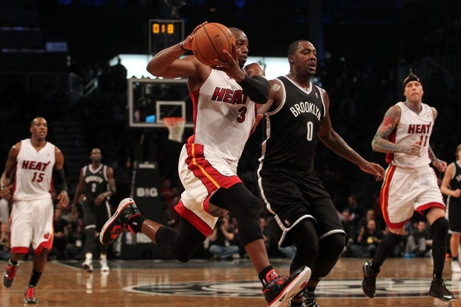 Nov 1, 2013; Brooklyn, NY, USA; Miami Heat shooting guard Dwyane Wade (3) drives to the basket past Brooklyn Nets center Andray Blatche (0) during the second quarter of a game at Barclays Center. Mandatory Credit: Brad Penner-USA TODAY Sports