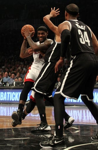 Nov 1, 2013; Brooklyn, NY, USA; Miami Heat small forward LeBron James (6) drives on Brooklyn Nets point guard Shaun Livingston (14) during the second quarter of a game at Barclays Center. Mandatory Credit: Brad Penner-USA TODAY Sports
