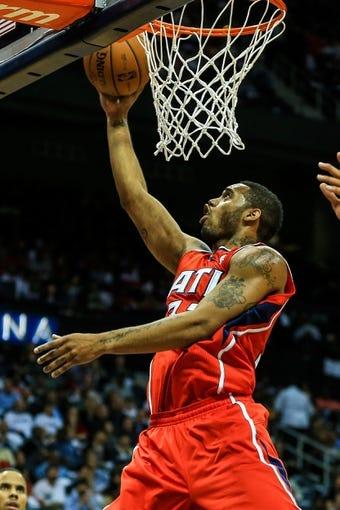 Nov 1, 2013; Atlanta, GA, USA; Atlanta Hawks power forward Mike Scott (32) shoots a basket in the second half against the Toronto Raptors at Philips Arena. The Hawks won 102-95. Mandatory Credit: Daniel Shirey-USA TODAY Sports