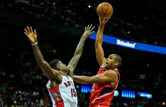 Nov 1, 2013; Atlanta, GA, USA; Atlanta Hawks center Al Horford (15) shoots a basket over Toronto Raptors power forward Amir Johnson (15) in the second half at Philips Arena. The Hawks won 102-95. Mandatory Credit: Daniel Shirey-USA TODAY Sports