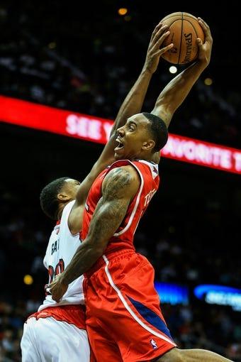 Nov 1, 2013; Atlanta, GA, USA; Toronto Raptors small forward Rudy Gay (22) blocks a shot by Atlanta Hawks point guard Jeff Teague (0) in the second half at Philips Arena. The Hawks won 102-95. Mandatory Credit: Daniel Shirey-USA TODAY Sports