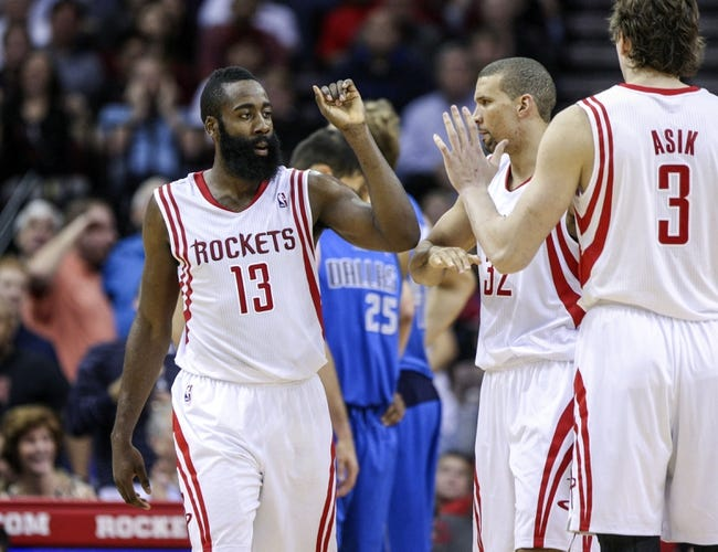 Nov 1, 2013; Houston, TX, USA; Houston Rockets shooting guard James Harden (13) is congratulated by shooting guard Francisco Garcia (32) and center Omer Asik (3) after a play during the fourth quarter against the Dallas Mavericks at Toyota Center. The Rockets defeated the Mavericks 113-105. Mandatory Credit: Troy Taormina-USA TODAY Sports