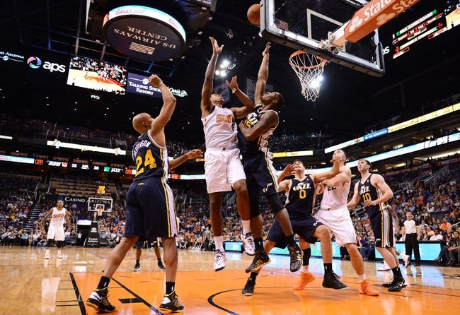 Nov 1, 2013; Phoenix, AZ, USA; Phoenix Suns forward Channing Frye (8) puts up a shot against the Utah Jazz forward Derrick Favors (15) in the first half at US Airways Center. Mandatory Credit: Jennifer Stewart-USA TODAY Sports
