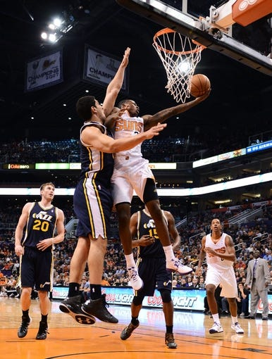 Nov 1, 2013; Phoenix, AZ, USA; Phoenix Suns guard Archie Goodwin (20) lays up the ball against the Utah Jazz center Enes Kanter (0) in the first half at US Airways Center. Mandatory Credit: Jennifer Stewart-USA TODAY Sports