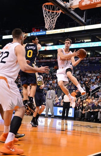 Nov 1, 2013; Phoenix, AZ, USA; Phoenix Suns guard Goran Dragic (1) makes a pass in traffic against the Utah Jazz in the first half at US Airways Center. Mandatory Credit: Jennifer Stewart-USA TODAY Sports