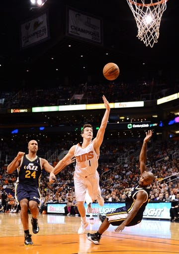 Nov 1, 2013; Phoenix, AZ, USA; Phoenix Suns guard Goran Dragic (1) commits an offensive foul against the Utah Jazz guard John Lucas III (5) in the first half at US Airways Center. Mandatory Credit: Jennifer Stewart-USA TODAY Sports