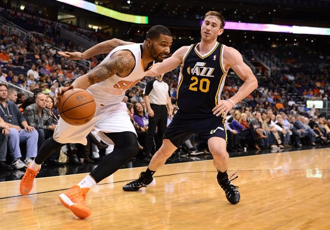 Nov 1, 2013; Phoenix, AZ, USA; Phoenix Suns forward Marcus Morris (15) drives the ball against the Utah Jazz forward Gordon Hayward (20) in the first half at US Airways Center. Mandatory Credit: Jennifer Stewart-USA TODAY Sports