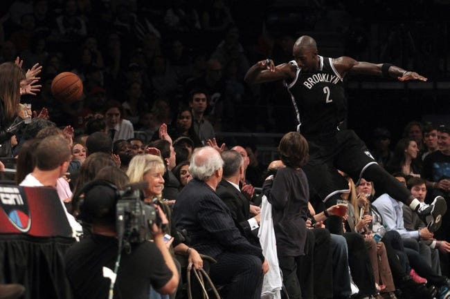 Nov 1, 2013; Brooklyn, NY, USA; Brooklyn Nets power forward Kevin Garnett (2) dives into the crowd to try and save a ball going out of bounds against the Miami Heat during the third quarter of a game at Barclays Center. Mandatory Credit: Brad Penner-USA TODAY Sports