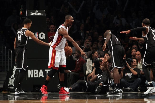 Nov 1, 2013; Brooklyn, NY, USA; Miami Heat center Chris Bosh (1) argues a call during the third quarter of a game against the Brooklyn Nets at Barclays Center. Mandatory Credit: Brad Penner-USA TODAY Sports