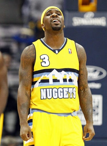 Nov 1, 2013; Denver, CO, USA; Denver Nuggets point guard Ty Lawson (3) reacts after a play in the second quarter against the Portland Trail Blazers at the Pepsi Center. The Trail Blazers won 113-98. Mandatory Credit: Isaiah J. Downing-USA TODAY Sports