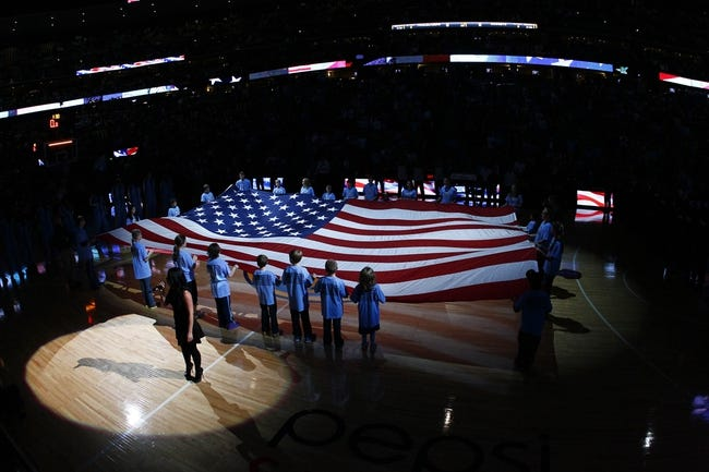 Nov 1, 2013; Denver, CO, USA; A general view as an American flag is held on the court before the start of the game between the Portland Trail Blazers and the Denver Nuggets at the Pepsi Center. The Trail Blazers won 113-98. Mandatory Credit: Isaiah J. Downing-USA TODAY Sports