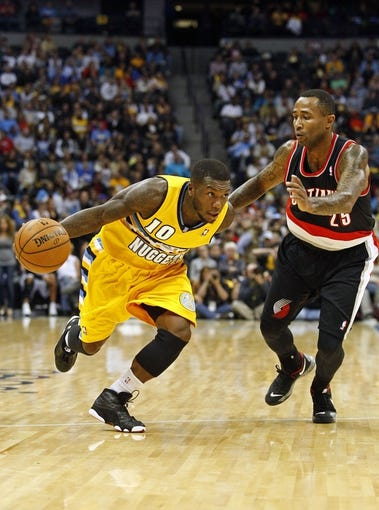 Nov 1, 2013; Denver, CO, USA; Portland Trail Blazers point guard Mo Williams (25) guards Denver Nuggets point guard Nate Robinson (10) in the fourth quarter at the Pepsi Center. The Trail Blazers won 113-98. Mandatory Credit: Isaiah J. Downing-USA TODAY Sports