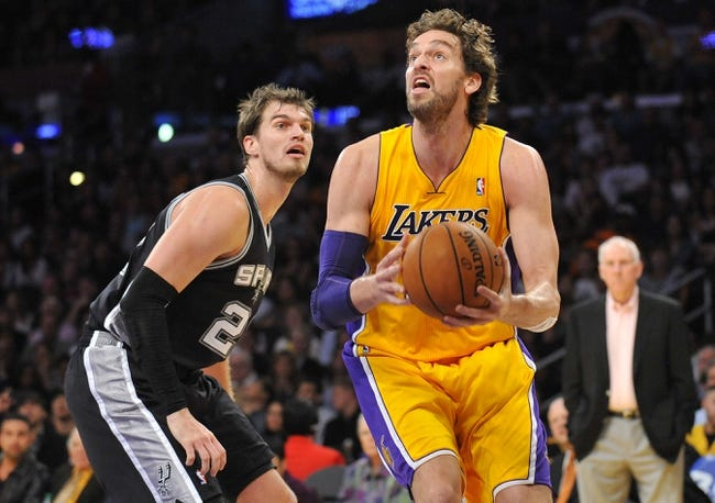 November 1, 2013; Los Angeles, CA, USA; Los Angeles Lakers power forward Pau Gasol (16) moves to the basket against the San Antonio Spurs during the first half at Staples Center. Mandatory Credit: Gary A. Vasquez-USA TODAY Sports