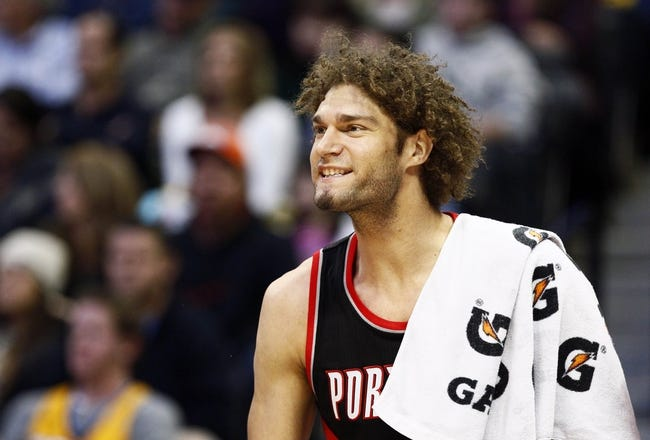 Nov 1, 2013; Denver, CO, USA; Portland Trail Blazers center Robin Lopez (42) reacts to a play in the third quarter against the Denver Nuggets at the Pepsi Center. The Trail Blazers won 113-98. Mandatory Credit: Isaiah J. Downing-USA TODAY Sports