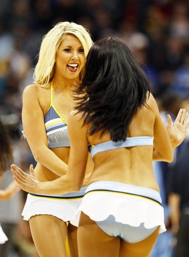 Nov 1, 2013; Denver, CO, USA; Denver Nuggets dancers perform in the fourth quarter of the game against the Portland Trail Blazers at the Pepsi Center. The Trail Blazers won 113-98. Mandatory Credit: Isaiah J. Downing-USA TODAY Sports
