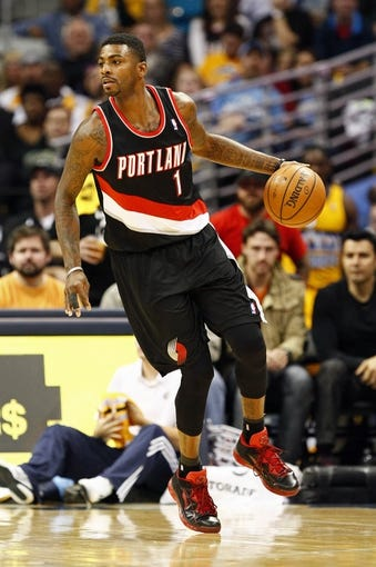 Nov 1, 2013; Denver, CO, USA; Portland Trail Blazers small forward Dorell Wright (1) controls the ball in the fourth quarter against the Denver Nuggets at the Pepsi Center. The Trail Blazers won 113-98. Mandatory Credit: Isaiah J. Downing-USA TODAY Sports