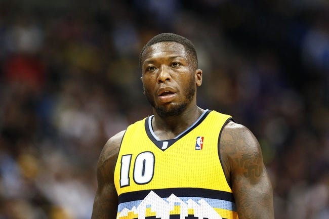 Nov 1, 2013; Denver, CO, USA; Denver Nuggets point guard Nate Robinson (10) in the third quarter against the Portland Trail Blazers at the Pepsi Center. The Trail Blazers won 113-98. Mandatory Credit: Isaiah J. Downing-USA TODAY Sports