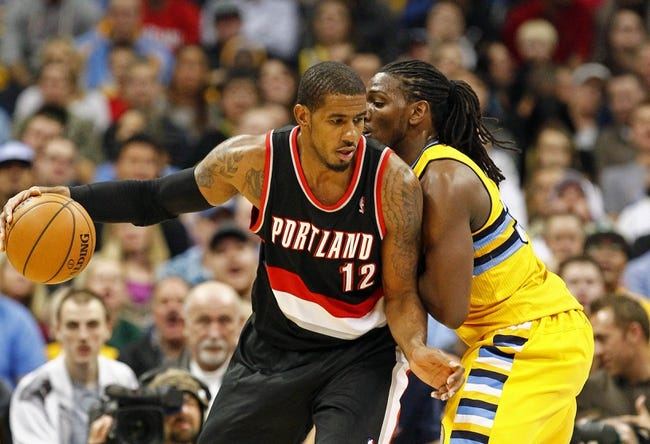 Nov 1, 2013; Denver, CO, USA; Denver Nuggets small forward Kenneth Faried (35) guards Portland Trail Blazers power forward LaMarcus Aldridge (12) in the fourth quarter at the Pepsi Center. The Trail Blazers won 113-98. Mandatory Credit: Isaiah J. Downing-USA TODAY Sports
