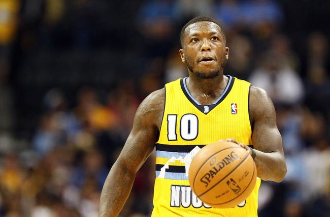 Nov 1, 2013; Denver, CO, USA; Denver Nuggets point guard Nate Robinson (10) controls the ball in the fourth quarter against the Portland Trail Blazers at the Pepsi Center. The Trail Blazers won 113-98. Mandatory Credit: Isaiah J. Downing-USA TODAY Sports