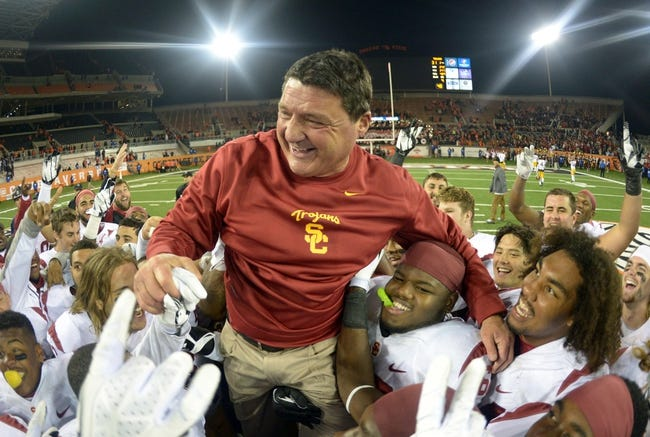 Nov 1, 2013; Corvallis, OR, USA; Southern California Trojans coach Ed Orgeron is hoisted by players in celebration after the game against the Oregon State Beavers at Reser Stadium. USC defeated Oregon State 31-14.  Mandatory Credit: Kirby Lee-USA TODAY Sports