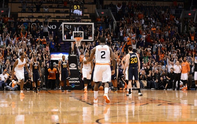 Nov 1, 2013; Phoenix, AZ, USA; Phoenix Suns guard Eric Bledsoe (2) scores the game winning 3 point shot against the Utah Jazz in the second half at US Airways Center. The Suns defeated the Jazz 87-84.  Mandatory Credit: Jennifer Stewart-USA TODAY Sports