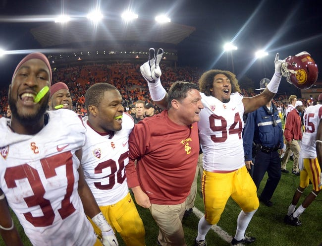 Nov 1, 2013; Corvallis, OR, USA; Southern California Trojans coach Ed Orgeron (second from right) celebrates with running back Javorius Allen (37), fullback Jahleel Pinner (38) and defensive end Leonard Williams (94) after the game against the Oregon State Beavers at Reser Stadium. USC defeated Oregon State 31-14.  Mandatory Credit: Kirby Lee-USA TODAY Sports
