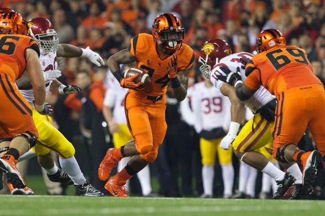 Nov 1, 2013; Corvallis, OR, USA;  Oregon State Beavers wide receiver John Carroll (34) runs up the middle against USC Trojans defenders at Reser Stadium. Mandatory Credit: Jaime Valdez-USA TODAY Sports