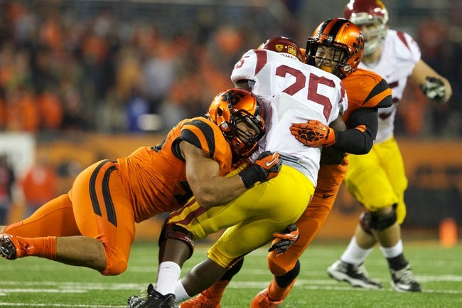 Nov 1, 2013; Corvallis, OR, USA;  Oregon State Beavers linebacker Rommel Mageo (46) and teammate Beavers safety Justin Strong (39) sacks USC Trojans running back Silas Redd (25) in the second half at Reser Stadium. Mandatory Credit: Jaime Valdez-USA TODAY Sports