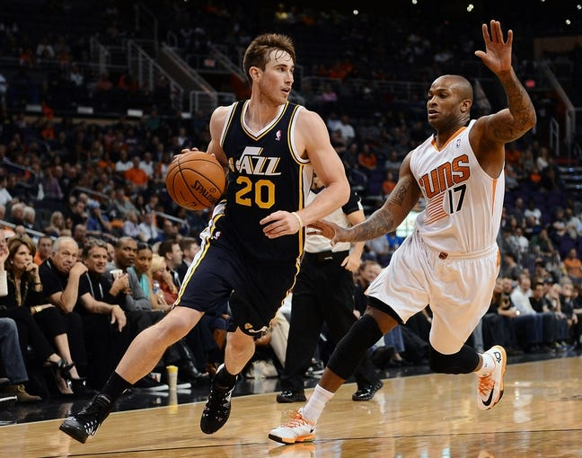 Nov 1, 2013; Phoenix, AZ, USA; Utah Jazz forward Gordon Hayward (20) handles the ball against the Phoenix Suns forward P.J Tucker (17) in the second half at US Airways Center.  The Suns defeated the Jazz 87-84. Mandatory Credit: Jennifer Stewart-USA TODAY Sports