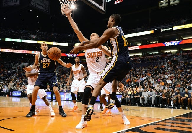 Nov 1, 2013; Phoenix, AZ, USA; Utah Jazz guard Alec Burks (10) makes a pass against the Phoenix Suns center Alex Len (21) in the second half at US Airways Center.  The Suns defeated the Jazz 87-84. Mandatory Credit: Jennifer Stewart-USA TODAY Sports