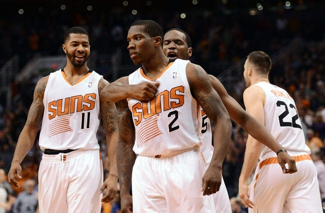 Nov 1, 2013; Phoenix, AZ, USA; Phoenix Suns guard Eric Bledsoe (2) is congratulated by teammates forward Markieff Morris (11)  and guard Dionte Christmas (25) after scoring the game winning 3 point basket against the Utah Jazz in the second half at US Airways Center. The Suns defeated the Jazz 87-84.  Mandatory Credit: Jennifer Stewart-USA TODAY Sports