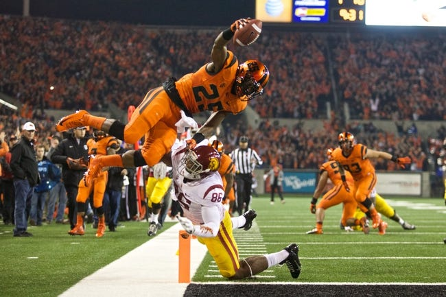 Nov 1, 2013; Corvallis, OR, USA;  Oregon State Beavers safety Ryan Murphy (25) flies into the end zone for a touchdown over USC Trojans tight end Xavier Grimble (86) in the first half at Reser Stadium. Mandatory Credit: Jaime Valdez-USA TODAY Sports