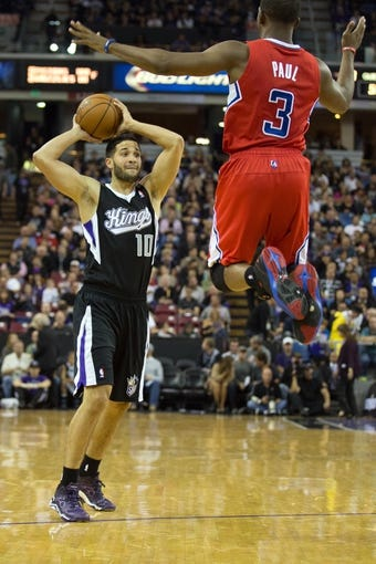 Nov 1, 2013; Sacramento, CA, USA; Sacramento Kings point guard Greivis Vasquez (10) passes the ball against Los Angeles Clippers point guard Chris Paul (3) during the third quarter at Sleep Train Arena. The Los Angeles Clippers defeated the Sacramento Kings 110-101. Mandatory Credit: Kelley L Cox-USA TODAY Sports