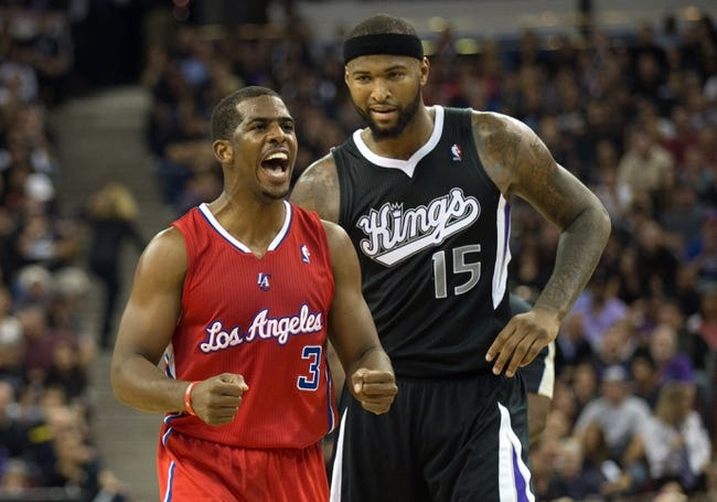 Nov 1, 2013; Sacramento, CA, USA; Los Angeles Clippers point guard Chris Paul (3) reacts after center Ryan Hollins (not pictured) fouls Sacramento Kings center DeMarcus Cousins (15) during the third quarter at Sleep Train Arena. The Los Angeles Clippers defeated the Sacramento Kings 110-101. Mandatory Credit: Kelley L Cox-USA TODAY Sports